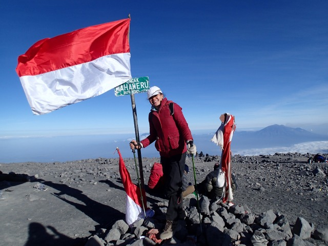 Mt. Semeru's active crater spewing smoke and rocks